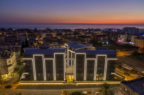 Современный проект в центре Аланьи в 350 метрах от пляжа Клеопатры, Аланья, Центр. Продажа.